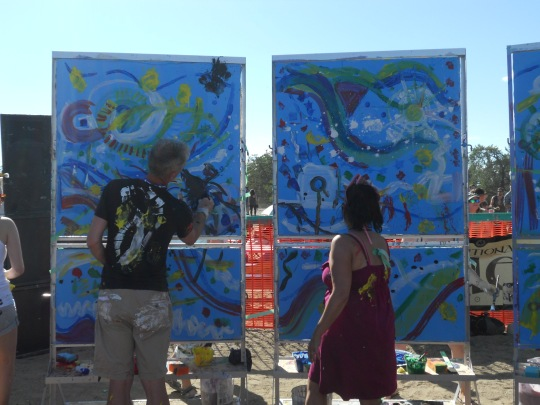 Members of BAM painting to the music
