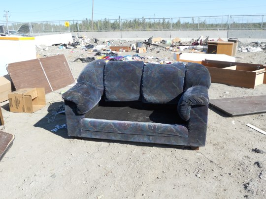 Couch, sans cushions, at the dump